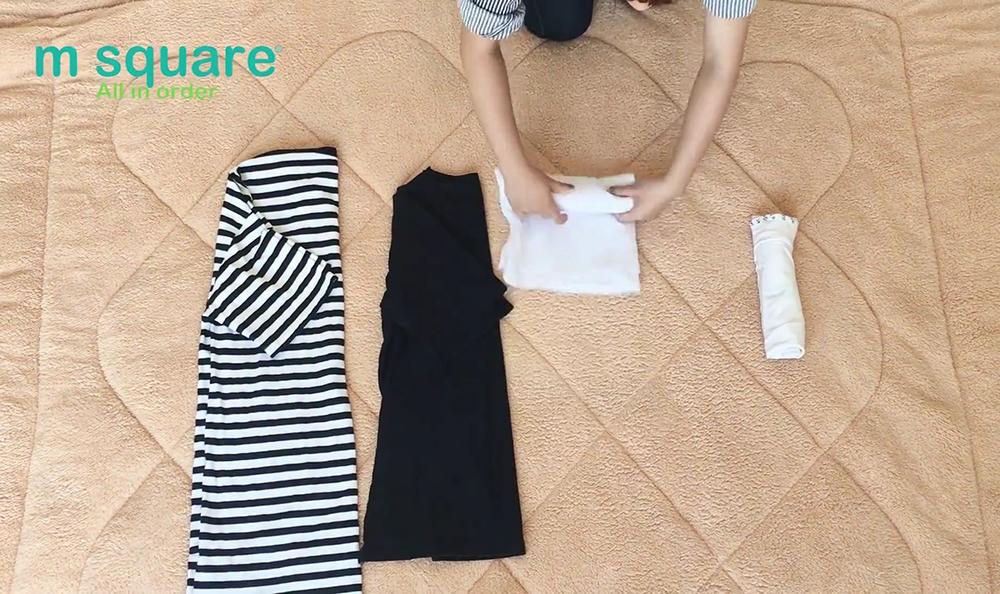 thu gọn quần áo với cách cuốn